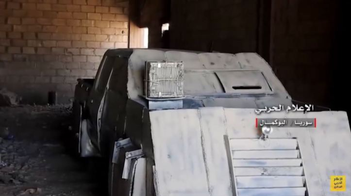 IS up-armored tan 4x4 SVBIED captured by loyalists in Abu Kamal. Very interesting payload w frontal exterior IED & 2 large aimed IEDs in the trunk (1)